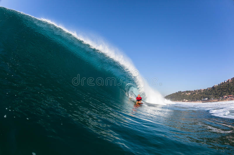 Surfing Inside Blue Hollow Crashing Wave stock photos
