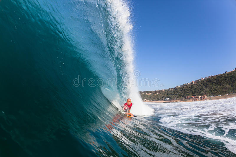 Surfing Inside Blue Hollow Crashing Wave stock photo