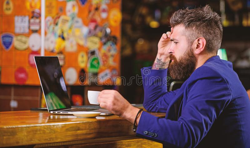 Surfing internet. Freelance benefit. Man bearded businessman sit pub with laptop and cup of coffee. Manager work online stock photography