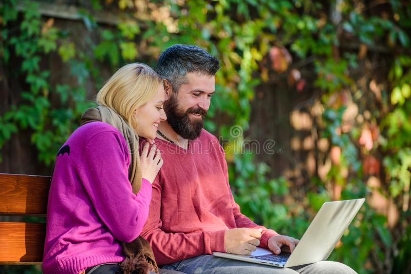 Surfing internet together. Family surfing internet for interesting content. Couple in love notebook consume content stock photography