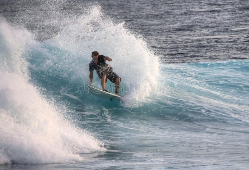 Surfing on Maldives stock images