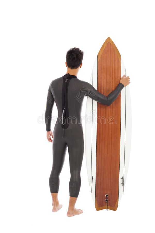 Surfing man wore wet suit and holding surfing board. In studio royalty free stock photo