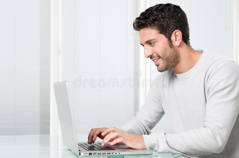 Surfing the net at home royalty free stock images