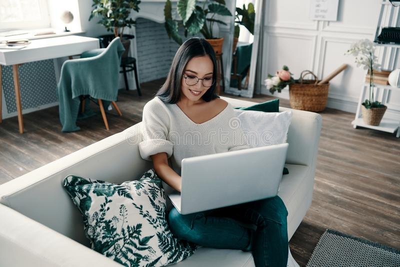 Surfing the net at home. royalty free stock image