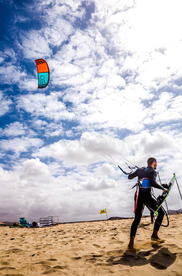 Surfing. Photograph of the beach in Lanzarote a man walking with a kite , Lanzarote, Canary Islands, Spain