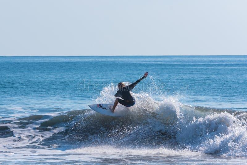 Surfing at playa hermosa en Costa Rica - pacific coast royalty free stock photo