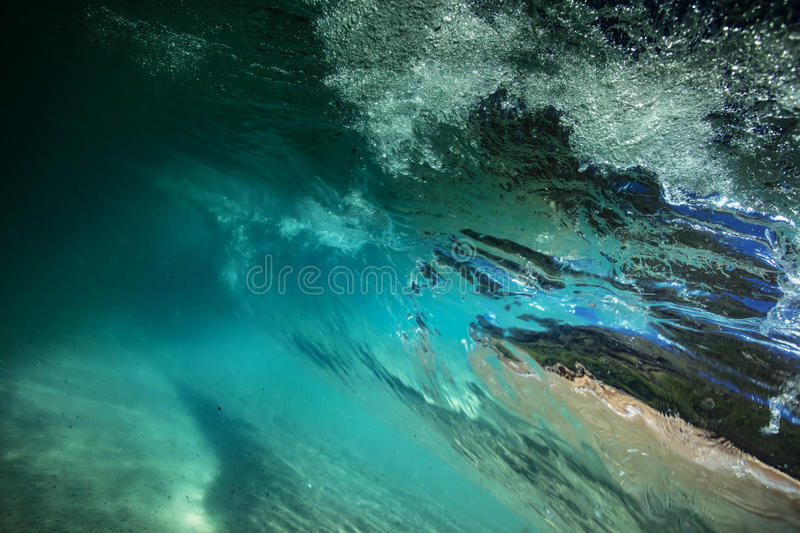 Bright colorful ocean wave underwater view sea background stock image