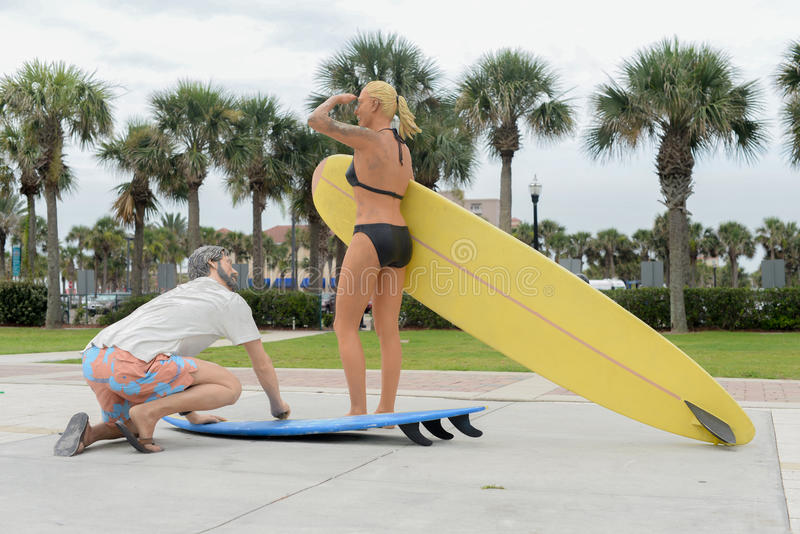 Surfing Statues at Jacksonville Beach in Florida. Brilliant morning light on the Jacksonville beaches Surfing Statues at Jacksonville Beach in Florida sunshine stock photos