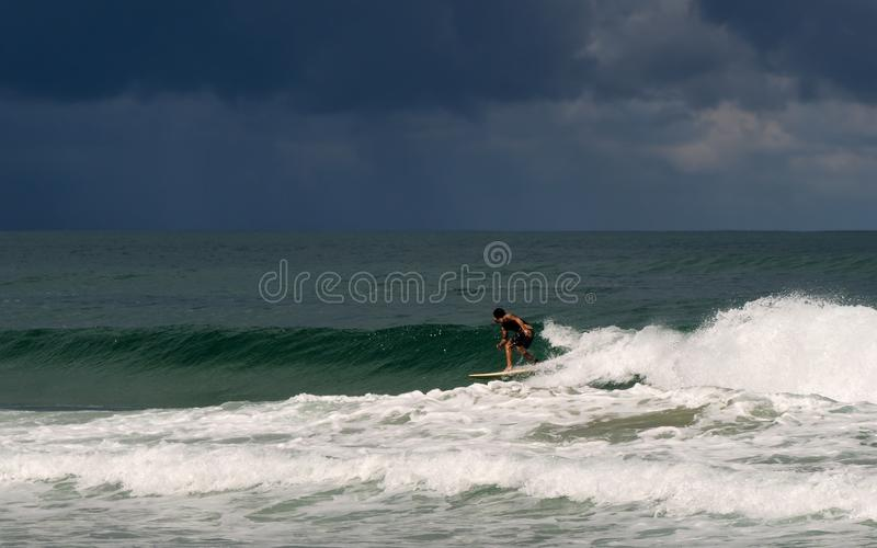 Surfing before the storm on Basque coast royalty free stock images