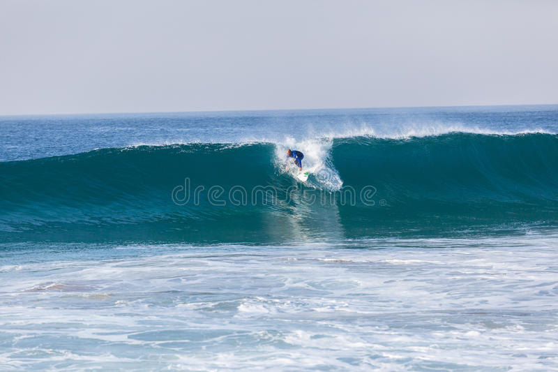 Surfing Surfer Catching Blue Wave royalty free stock image