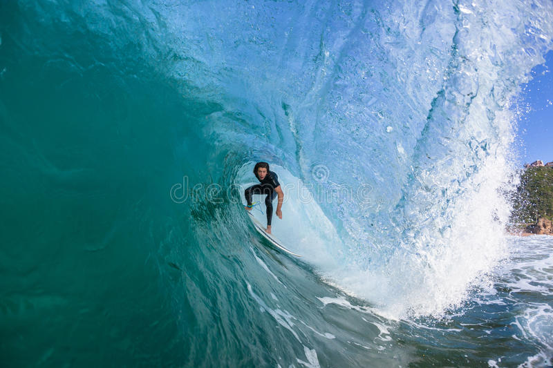 Surfing Surfer Inside Tube Ride. Surfer surfing inside hollow wave tube ride closeup up water action photo sequence stock images