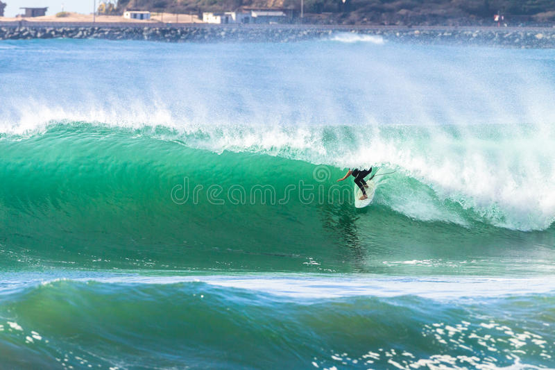 Surfing Surfer Tube Rides Wave royalty free stock image