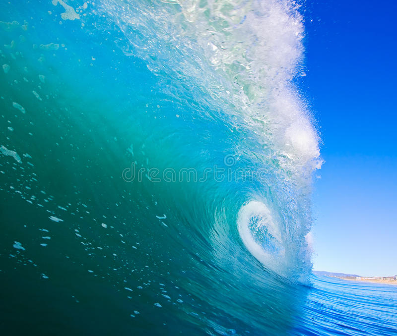 Surfing Wave. Large Blue Surfing Wave Breaks in Ocean royalty free stock image