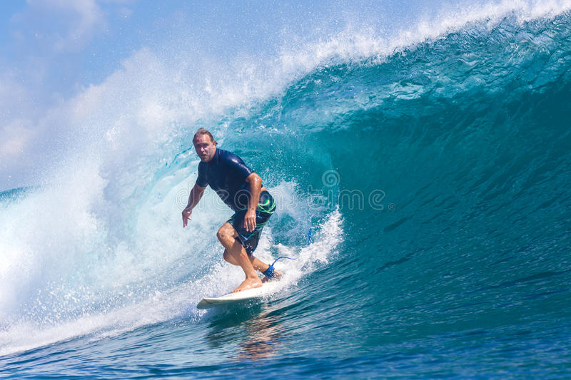Surfing a Wave.GLand Surf Area.Indonesia. royalty free stock images