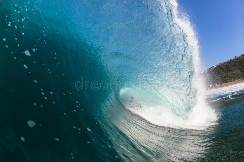 Surfing Wipe Out Inside Blue Hollow Crashing Wave royalty free stock photo