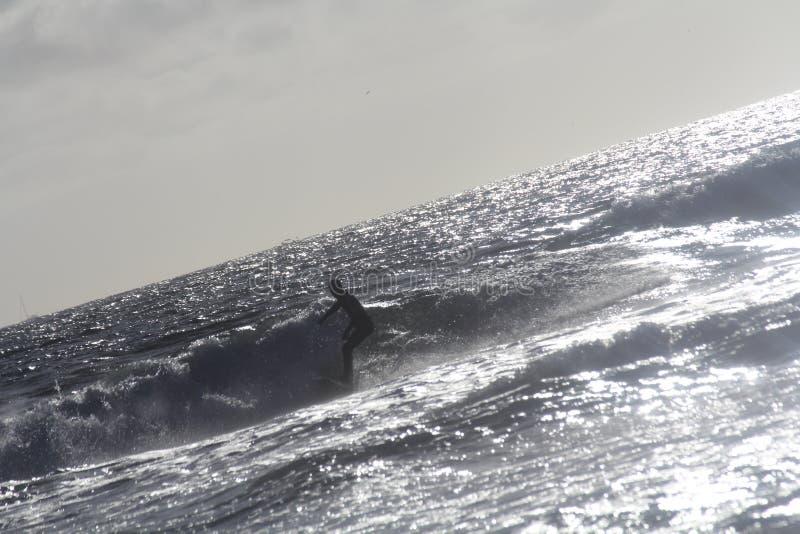 Surfista da silhueta imagens de stock royalty free