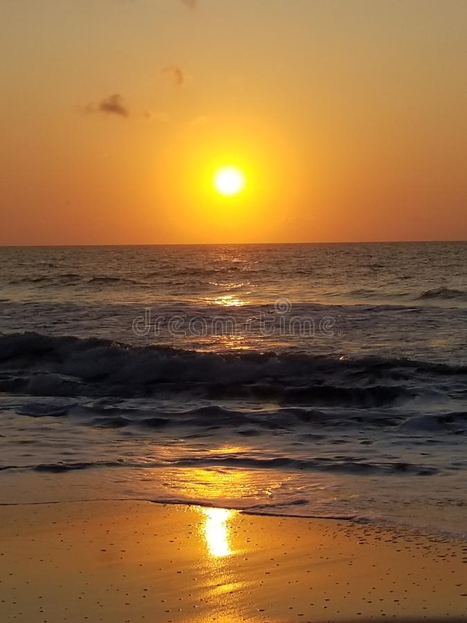 Surfside Beach reflective sunrise SeptemberSeptember stock photo