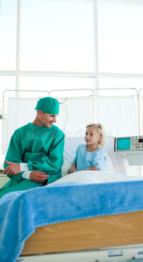 Surgeon Discussing A Patient Case History Stock Images