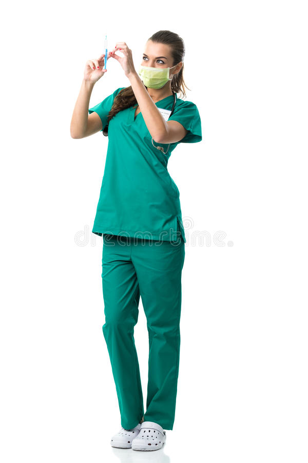 surgeon in green mouth mask,holding the injection royalty free stock image
