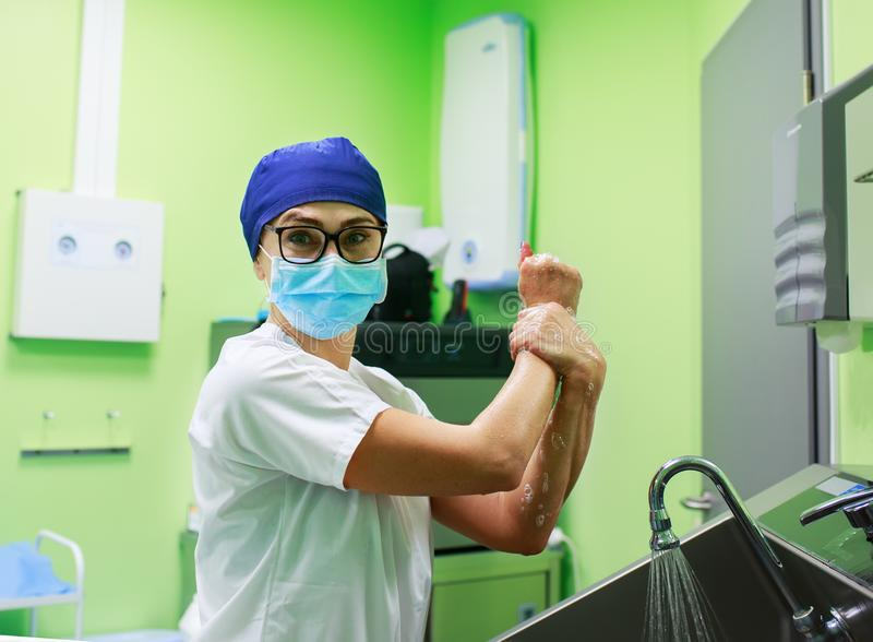 Surgeon in the hospital washing hands royalty free stock images