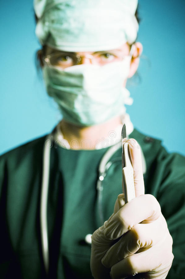 Surgeon medic with scalpel royalty free stock photo