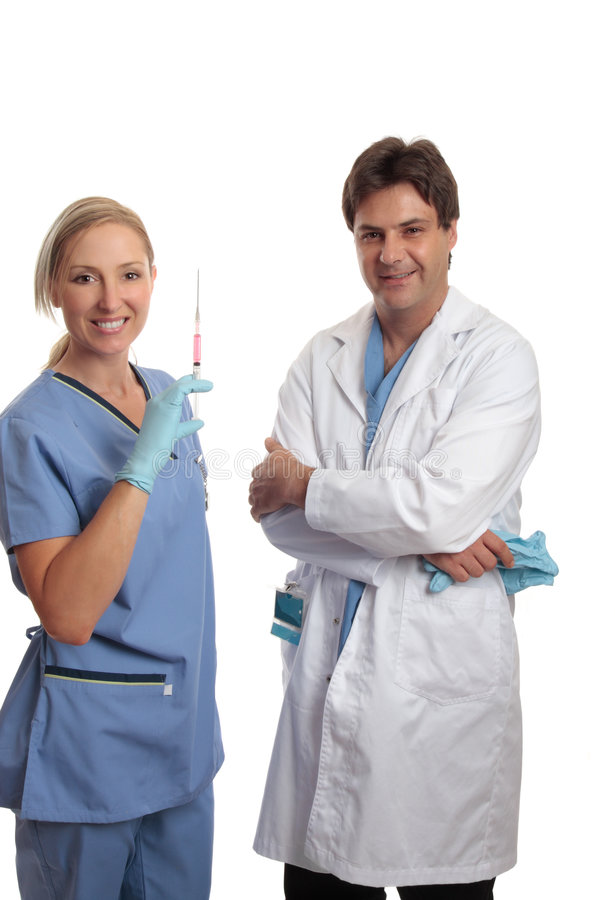 Surgeon and scrub nurse stock photo