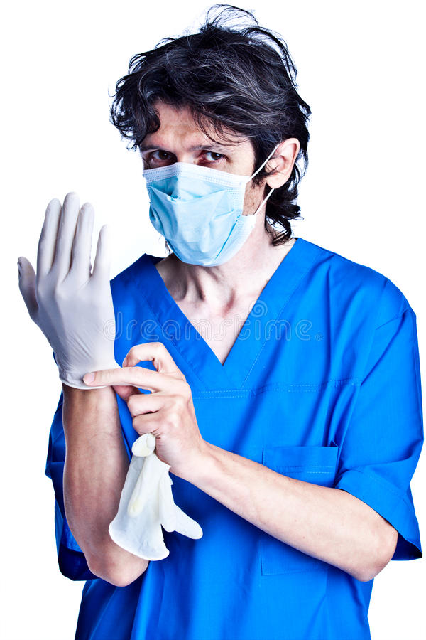 Free Surgeon Struggle Into Gloves On Hands Stock Image - 12819021