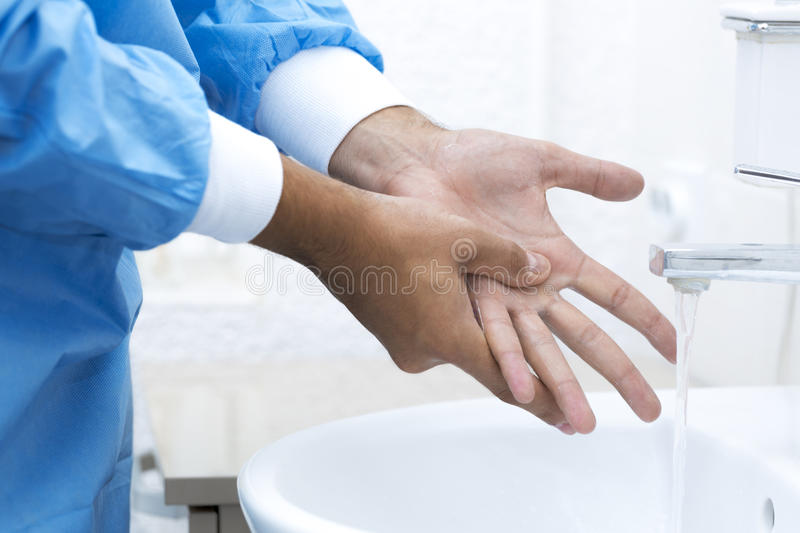 Surgeon washing hands before surgery royalty free stock images