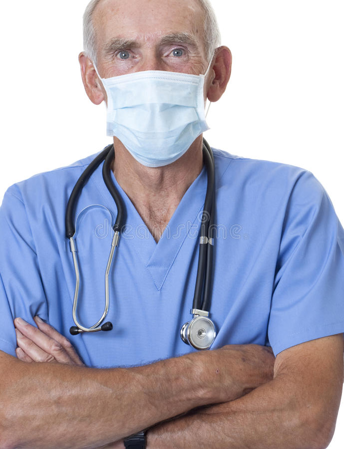 Surgeon wearing scrubs and face mask. Doctor or nurse dressed in scrubs wearing face mask for prevention of infection. Shot against a white background stock photo