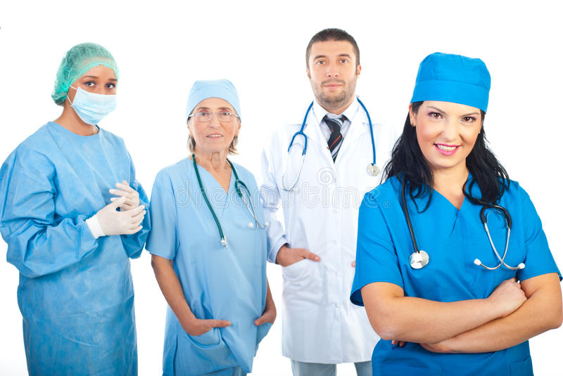 Surgeon Woman And Her Team Royalty Free Stock Photos