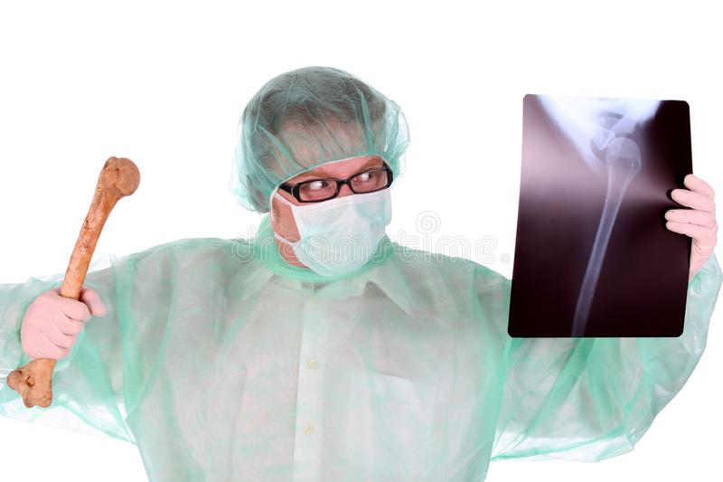 Surgeon with xray and bone royalty free stock photo