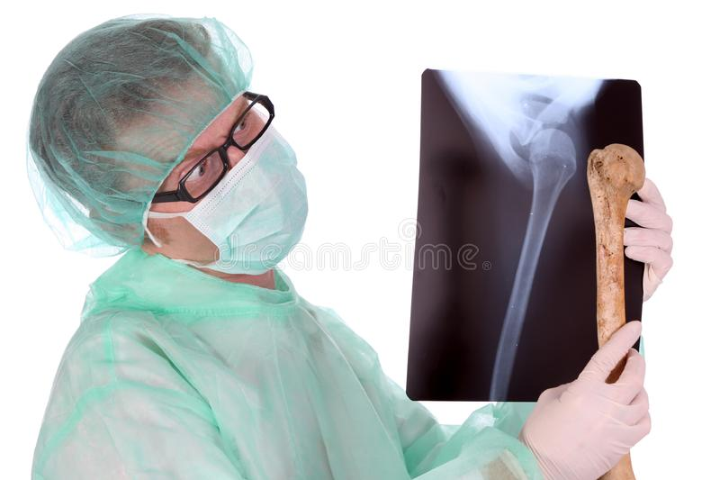 Surgeon with xray and bone stock photo