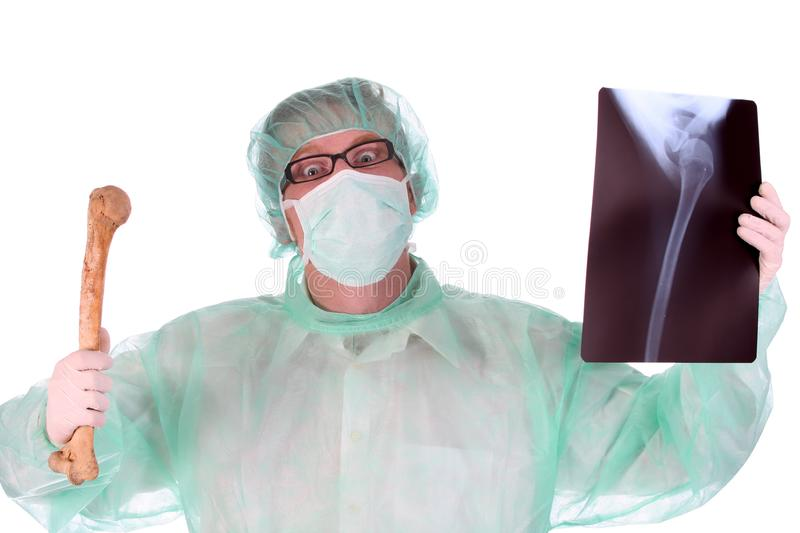 Surgeon with xray and bone royalty free stock images