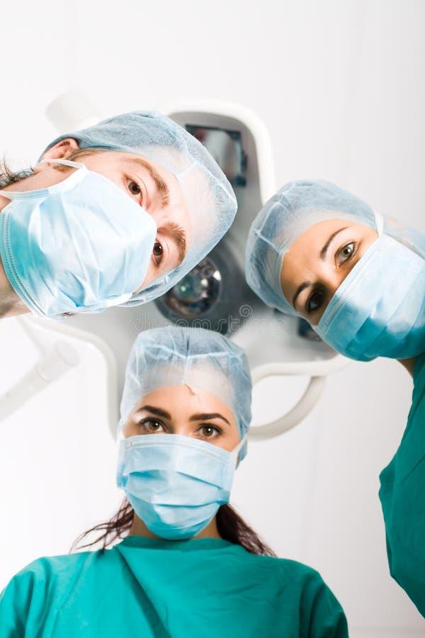 Surgeons stock photos
