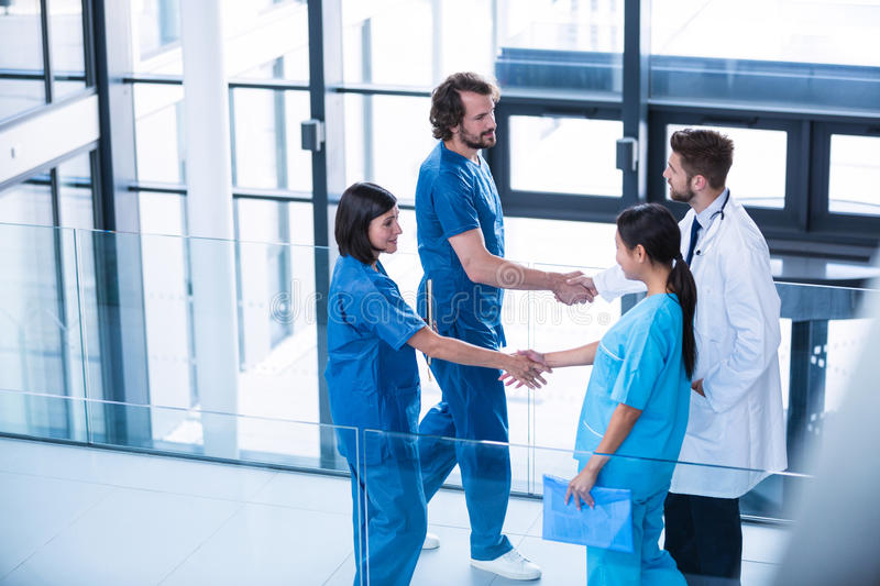 Surgeons, doctor and nurse shaking hands with each other royalty free stock photo