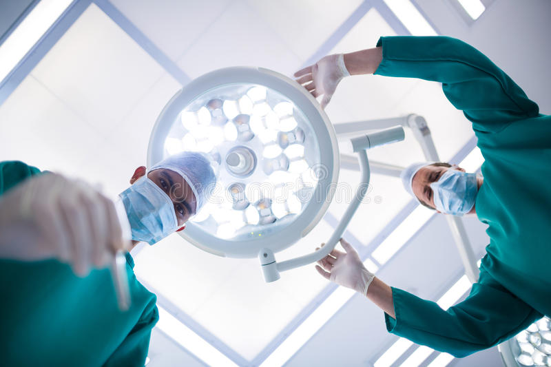 Surgeons operating in operation theater stock image