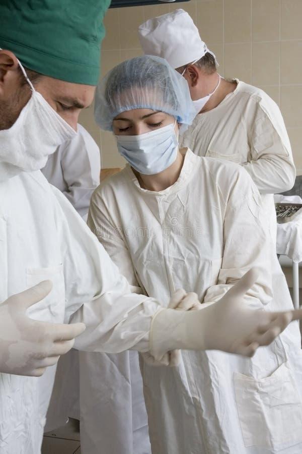 Surgeons team. Are preparing at work royalty free stock photos