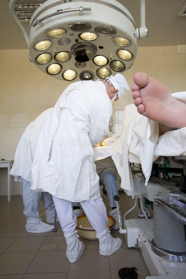 Surgeons team at work royalty free stock images