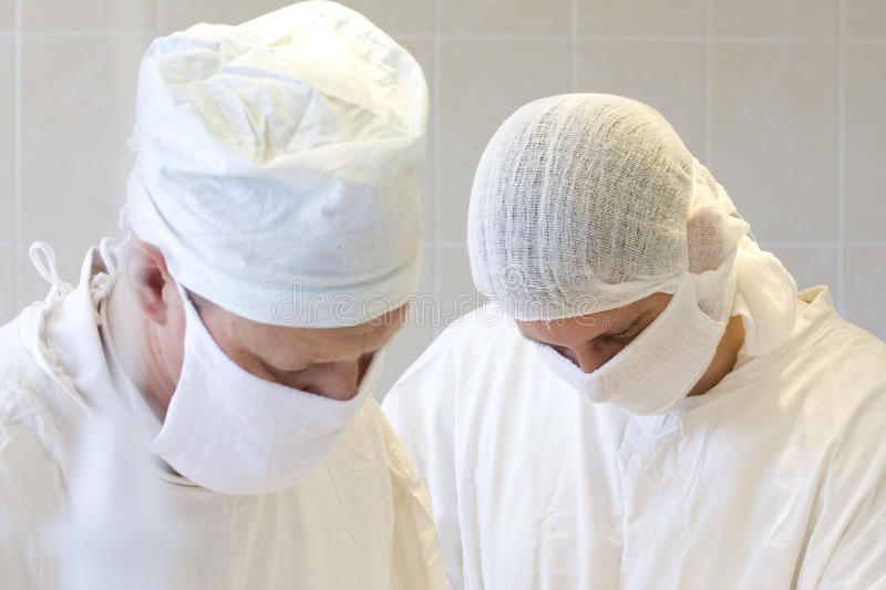 Surgeons team at work. In operative room stock photo