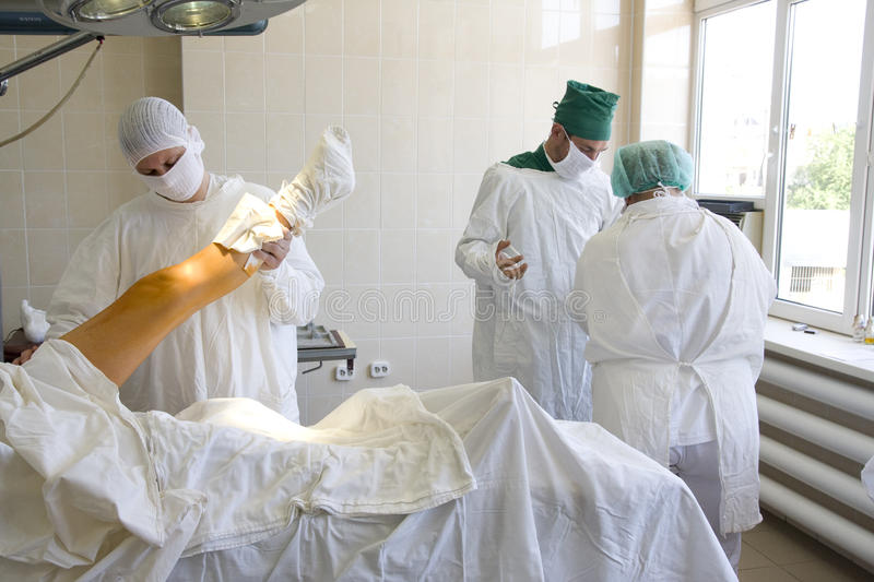 Surgeons team at work. In operative room royalty free stock photos
