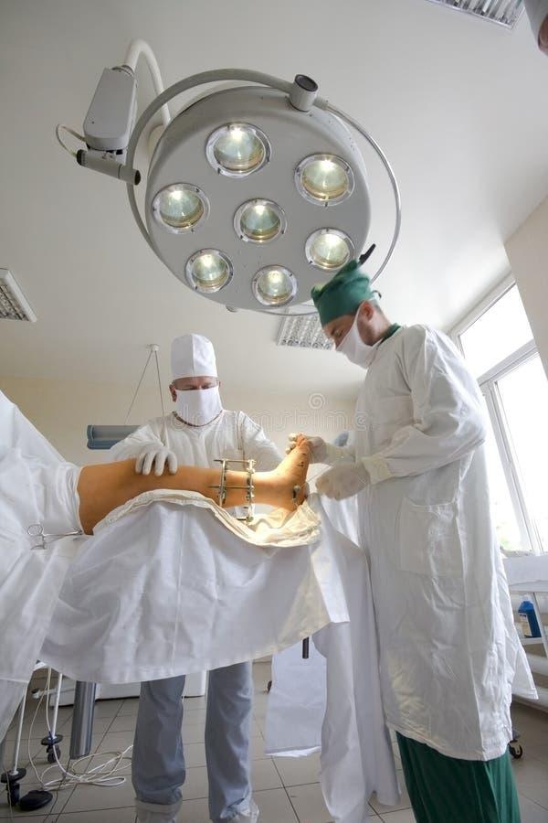 Surgeons team at work stock photos