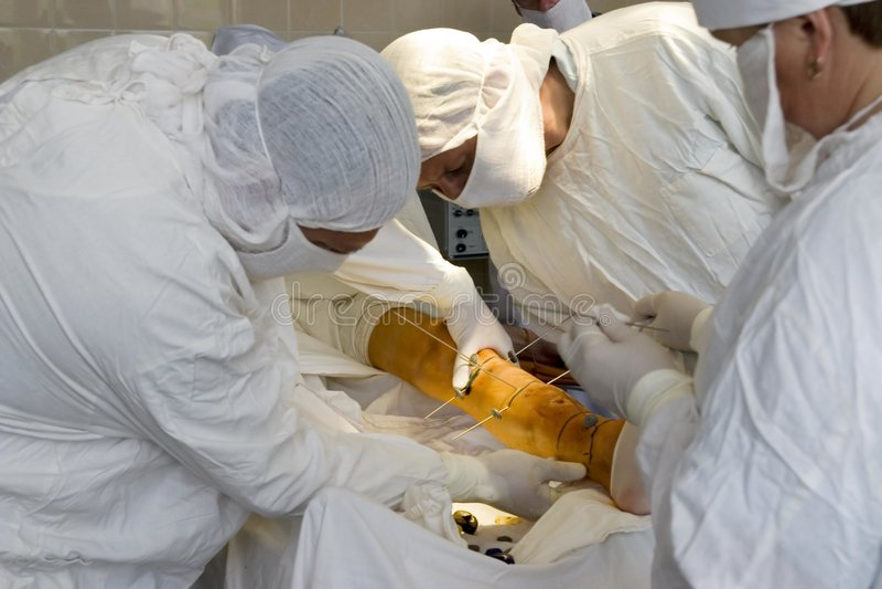 Surgeons at work royalty free stock image