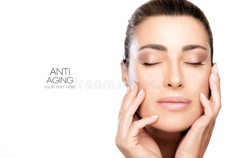 Surgery and Anti Aging Concept. Beauty Face Spa Woman. Anti aging treatment and plastic surgery concept. Beautiful young woman with hands on cheeks and eyes royalty free stock image