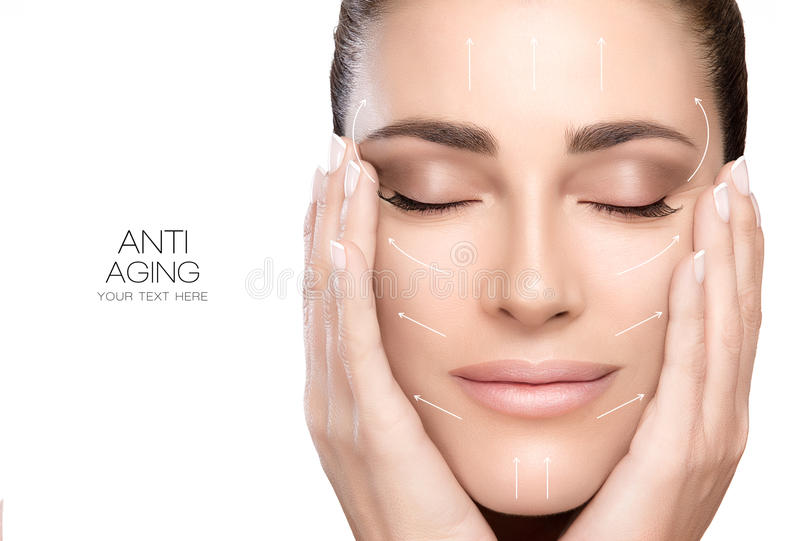 Surgery and Anti Aging Concept. Beauty Face Spa Woman. Anti aging treatment and plastic surgery concept. Beautiful young woman with hands on cheeks and eyes stock images