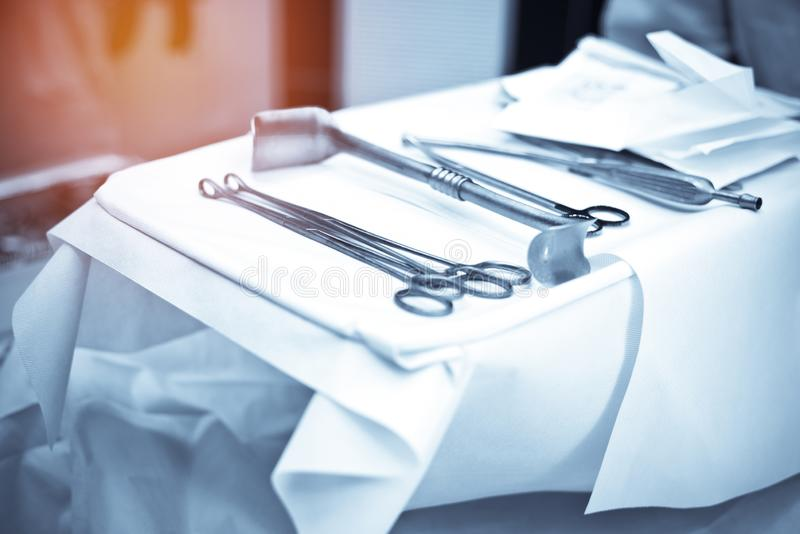 Surgery instrument and tools set on white sterile fabric in operating room at hospital. Medical and Healthcare concept. Emergency royalty free stock photo