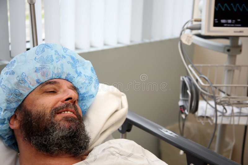 Surgery patient 1. Patient in the recovery room after having surgery royalty free stock photo