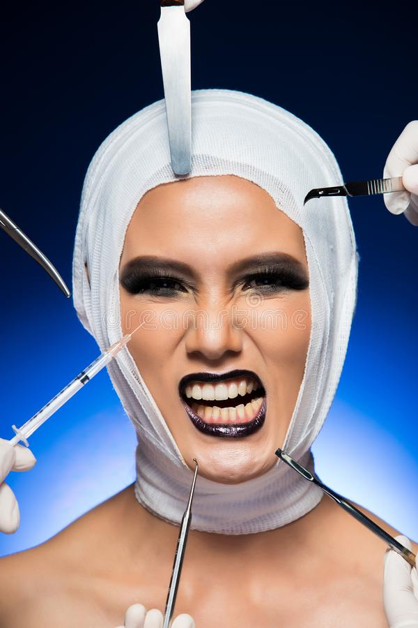 Surgery Patient bandage equipment around head. Beauty Aesthetic Plastic Surgery Patient with bandage, surgical tools, equipment around head. Studio Lighting stock images