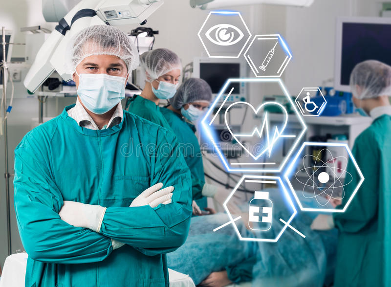 Surgery team with futuristic healthcare icons stock images