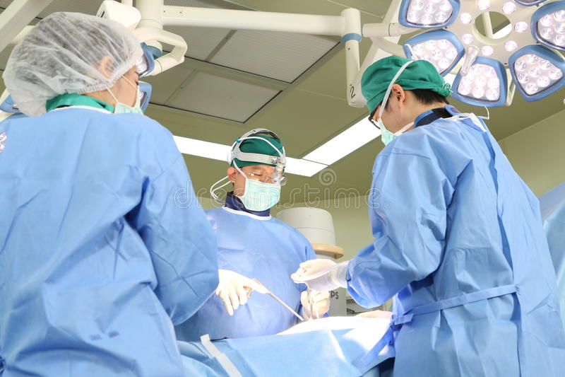 Surgery team operate. Two paramedics cheerfully removing empty gurney from ambulance royalty free stock photography