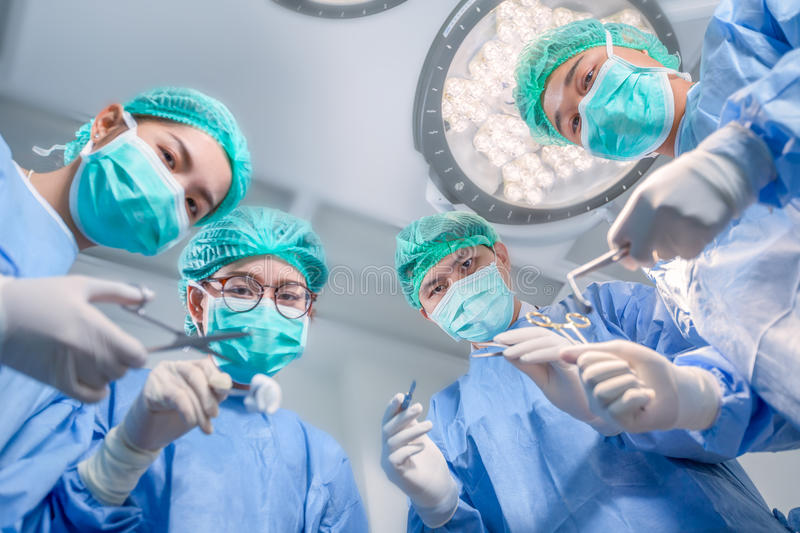Surgery team operating in a surgical room royalty free stock images